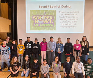 Steele Helps Tackle Hunger Through Souper Bowl of Caring